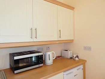 Kitchen with microwave, kettle and toaster